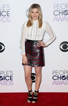 Chloe Grace Moretz in white Louis Vuitton top and striped leather skirt at the 2015 People's Choice Awards