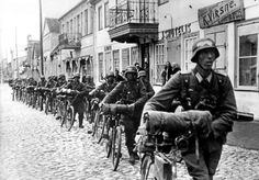 German Wehrmacht bicycle troops march through the streets of Lithuania, following the retreating Soviet Army. Kaunas, Kaunas County, Lithuania. June 1941.