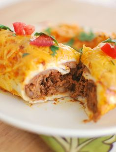 Smothered Burritos - beef cooked in the crockpot, wrapped in tortillas, and covered in sauce and cheese! So delicious! Mexican Dishes, Mexican Food Recipes, Beef Recipes, Cooking Recipes, Burrito Recipes, Mexican Meals, Mexican Desserts, Freezer Recipes, Freezer Cooking
