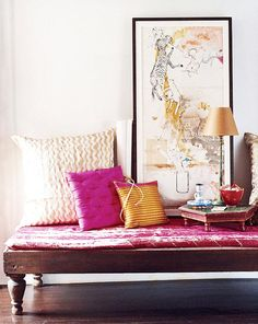 Pink and gold living room. Love the artwork!