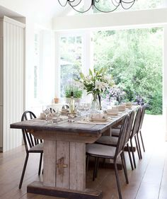 Great, long farmhouse table. Choose less clunky chairs to avoid space getting weighed down. Keep linens light.