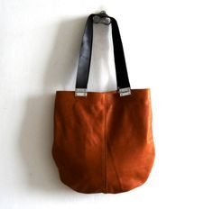 Tan brown  leather bag with black strips and hinges par Smadars, $155.00