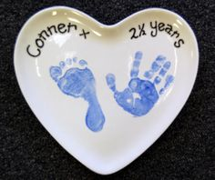 Footprints on heart shaped ceramic pottery plate.