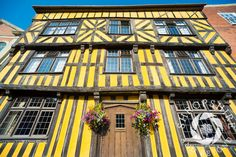 Hanging baskets outside a half-timbered house in Broad Street, #Ludlow, #Shropshire, England.