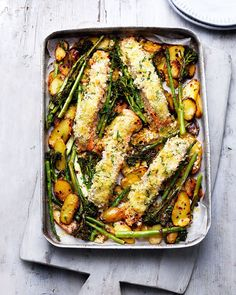 Tray roast salmon and vegetables with crème fraîche and crumbs. Midweek dinner couldn't be any easier than combining breadcrumb-coated salmon fillets with slice potatoes, broccoli and asparagus in one tray then popping it in the oven to bake. Baked Salmon Recipes, Seafood Recipes, Salmon Recepies, Tuna Recipes, Side Recipes, Pasta Recipes, Healthy Recipes, Cooking Recipes, Savoury Recipes