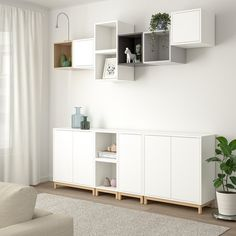 EKET Storage combination with legs, white/light gray. With the EKET series you can build your storage big, small, colorful or discreet to either display or hide your things. And if your space and needs change, you can easily change your EKET solution too. Ikea Storage, Cube Storage, Ikea Living Room Storage, Wall Cabinets Living Room, Storage Organizers, Ikea Eket, Painted Drawers, White Stain, Wall Design