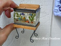 1:12 scale miniature aquarium made from a Reutter Porzellan box. Glow in the dark tape on the underside of the top illuminates it at night! ~Made by Nina Eary~