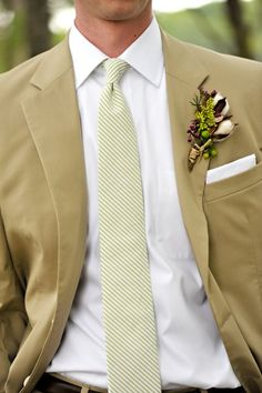 Groom and Groomsmen suits are tan cotton, they will wear white shirts and tan ties