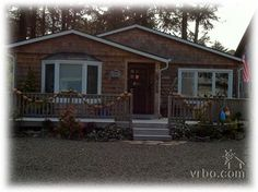 """""""Great Escape"""" at Cannon Beach - $1900/week including cleaning & dog fee. 3 bedrooms, 2 baths, dog & kid friendly, fenced yard w/ fire pit. 1 1/2 blocks to beach. Sleeps 7."""