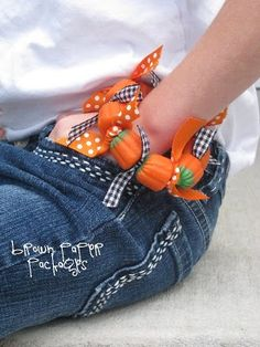 Candy pumpkin bracelets (may consider using wire instead of floss)