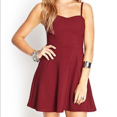 Forever 21 Fit and Flare Dress Gorgeous wine colored dress. Fully lined. Back zipper closure. The bodice has soft cup inserts, so you could go braless if you wanted to - Always a plus to me! Lol! New with tags, tried on, never worn. Forever 21 Dresses