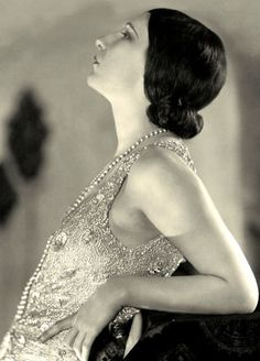 Fashion: 1920s flapper. Flappers had both an image and an attitude. To look more like a boy the flappers would wind cloth around their chests to flatten them. The waists of clothes were dropped to the hipline.