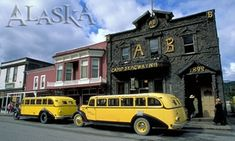 What to Do in Skagway, Alaska--Take a City Tour: The Skagway Street Car Company (with their vintage 1927 bright yellow buses) park in front of the Arctic Brotherhood Building.