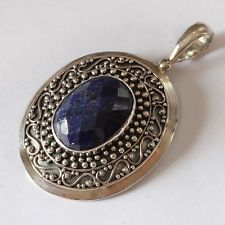 Sterling Silver Pendant with 15.01 ct Genuine Faceted Oval Sapphire. Lot 1021