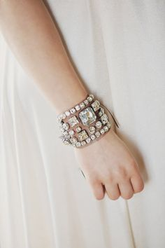 This is on Etsy and is a wrist wrapt of diamonds faux secured to a mesh and only  for the top part of wrist, it has two ties to hold it on. Very chic, I think!