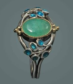 Jessie M. King for Liberty & Co. Arts and Crafts ring. Silver, gold, enamel and chrysoprase. H: 1.2 cm (0.47 in). British, c. 1900. Sold by Tadema Gallery. View 3.