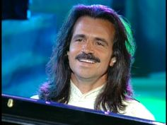 Yanni.  Saw him on Friday night and I'm in love all over again!  Also, with his music!!!  :)