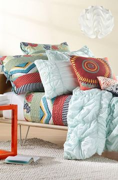 Love the mint ruffles paired with mixed patterns on this bedding!