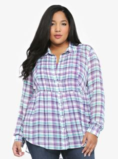 With a turquoise and purple plaid pattern, this white chiffon tunic is the definition of cool, easy style. Sewn-in pleats along the button-up front give a nod to the now-trending tuxedo look, while a tie-back helps shape the relaxed hi-lo silhouette. Button-tabbed sleeves.
