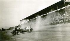 Car 11 in front of the grandstand at the Kern County Fair Association Race Track, circa 1919