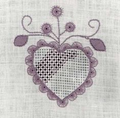 Schwalm, lots of info on fabric,thread, stitches and a free pattern with stitch instructions