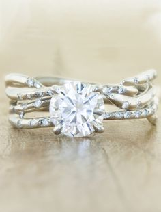 Unique engagement ring maybe add sidestones? No plating so it has the champagne finish.