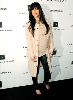 Kim Kardashian wears a trench with tight leather pants