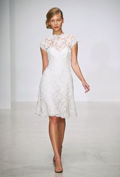DESIGNER: Amsale STYLE: Chloe NECKLINE: Sweetheart under lace illusion high neck SILHOUETTE: Short A-line FABRIC: Alencon Lace COLOR: Ivory FEATURES: Sheer lace cap sleeves with sheer lace covered back and small slit opening TRAIN: None CONDITION: Sample from boutique, no rips, tears, or stains SIZE: 10 PRICE: $1,800.00
