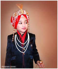 Punjabi sikh boy, a sarbala (usually a younger brother or nephew of the bridegroom) during a marriage ceremony.