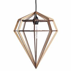 Aveva Large Raw Lamp: The simplestmaterial and form combine perfectly with striking effect in the wonderful laser-cut Raw Lamp from Swedish brandAveva. The diamond-shaped lamp is designed to be used either as a pendant or floor/table lamp and either way produces some impressive shadows.