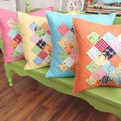 Lori Holt's blog and books - These photos are from her book Great Granny Squared and it includes instructions on exactly how to do the back of the pillows:)