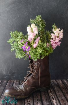 Turn anything into a vase!  This unconventional floral arrangement was perfect for the Equestrian Tea Party Birthday.  And Dad's paddock boots didn't even get soggy.