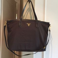 Authentic dark brown PRADA TOTE/CROSSBODY Seldom worn purchased in NYC/PRADA flagship store, removable long strap for crossbody use, gold hardware spacious and organized large pocket and zipper inside. Easy to pack,lightweight. Zip stop security sold the bag for me. Comes with authenticity card and dust bag. Prada Bags Totes