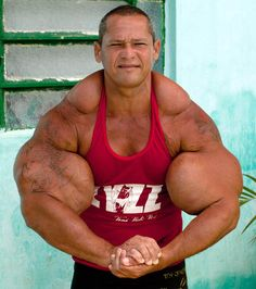 Muscle addict injects OIL and ALCOHOL into his arms to get 29 inch biceps