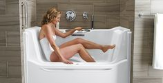 nice universal bathtub design lets you sit & slide into the tub & raise the wall