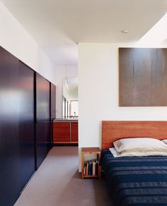 Sliding closet doors line one wall of the master bedroom of this renovated ranch-style home in Portland, Oregon, giving the room a calming, minimalist look. Photo by John Clark.  Photo by John Clark.