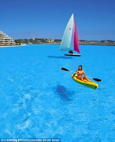 Crystal Lagoon..San Alfonso del Mar resort in Chile.....world's biggest swimming pool!...and there is a boat on it.  SO awesome.