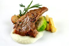 Sautéed rosemary and thyme lamb chops with butter braised root vegetables and cauliflower puree.