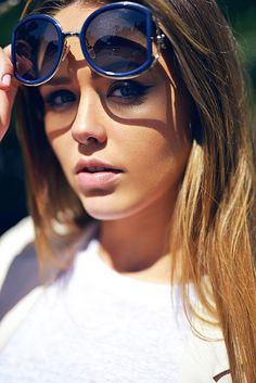 Kayture blogger in blue oversized sunglasses