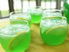 Green Punch for St. Patrick's Day Party Drinks. Kid-friendly. Made with Lemon-Lime Koolaid, Frozen Lemonade, Ginger Ale and Pineapple Juice.