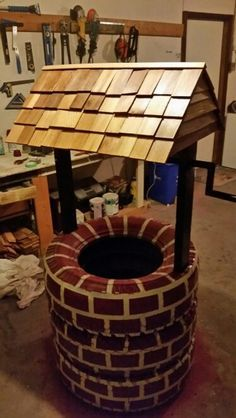 Wishing well planter made from recycled tires | The Owner-Builder Network