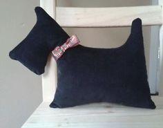 Handmade decorative scottie dog pillow made with black corduroy.