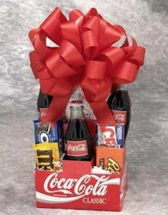 Coke Pack Gift Basket - Classic Coke, childhood chocolate favorites, popcorn and Wrigley's gum will make you feel like a kid again. Make the day special with the Coke Pack gift basket.