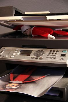 Haha...this is a good one :)  Elf on the shelf. SOOOOO doing this at work this year!!! My work peeps will love this ♥