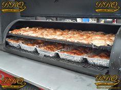 "100# Chicken Quarters smoking on a 24""x 60"" Gator Pit."
