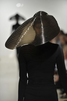 United Kingdom-based Gorman used alternative techniques like laser cutting and unusual materials like plastic, wood and leather to build these dramatic forms. These hats are so exotic!