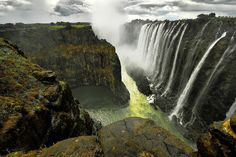 """Victoria Falls    """"This is a second photograph of the wonderful Victoria falls as seen from Zambia. The prominent rock formation to the distant left is Zimbabwe. The spray was quite bad on this day as it was windy, so I got drenched. But it was a fantastic experience all the same."""""""