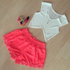 Gorgeous coral lace modern shorts with top white cutout blouse and chain and braslate and nail polish the best simple teenage outfits