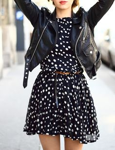 Polka dot dress that stops at mid thigh with a brown belt.