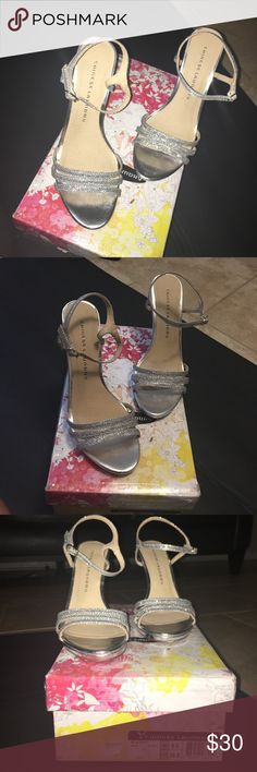 Woman's high heels Beautiful silver sparkly high heels. Great for special occasions (worn 3X) may run small. I am 7 1/2 and they fit great! *make offers* some wear on heel but not noticeable when wearing them..FREE SHIPPING/ make an offer of ‼️27 minus the shipping fee and it's yours‼️ Chinese Laundry Shoes Heels